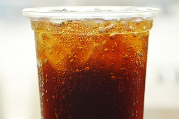 soda with ice in plastic cup