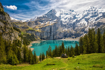 Foto op Canvas Alpen Amazing tourquise Oeschinnensee with waterfalls, wooden chalet and Swiss Alps, Berner Oberland, Switzerland.