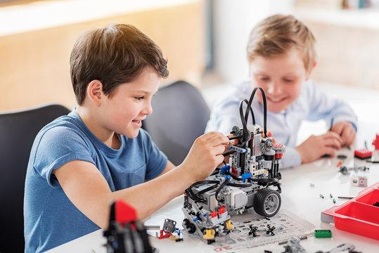 Happy smiling boys having fun in workshop
