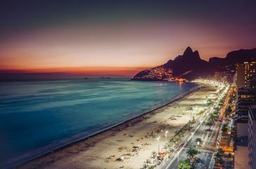 Sunset on Ipanema Beach and coastline street, Rio de Janeiro, Brazil