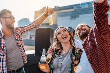 Positive guy and girl making selfie on party