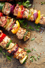 Grilled meat and vegetable skewers, top view
