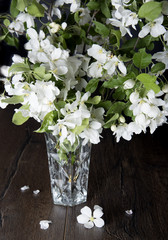 A bouquet of jasmine flowers on a rustic table