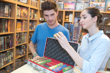 Girl looking at casino chips in store