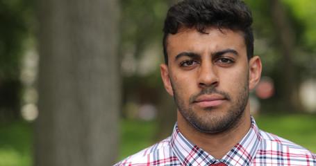 Young man in city park face portrait