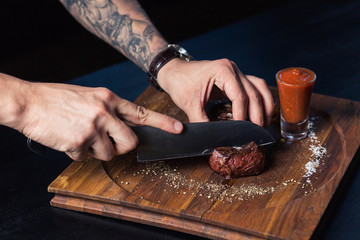 Wall Mural - chef cooking food kitchen restaurant cutting cook hands hotel man male knife preparation fresh preparing concept - stock image