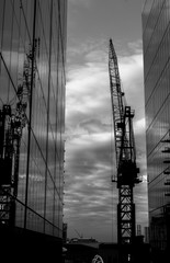 Cranes with its refelction off office windows