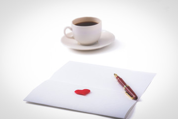 Gift card with heart and cup of coffee on wooden table