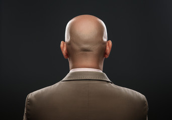 The back of a bald man in suit Wall mural