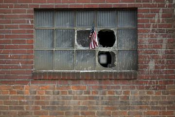 A U.S. flag is stuck in the broken window of a building in Bethlehem