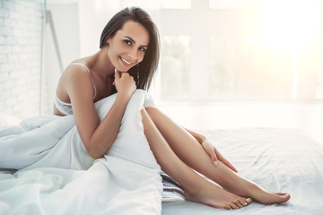 Charming young woman at home