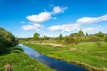 Panorama of the village of Mikhailovskoye in a Sunny spring day.
