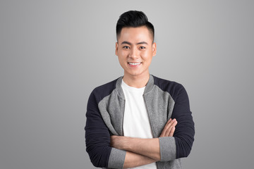 Portrait of cool handsome asian man with arms crossed
