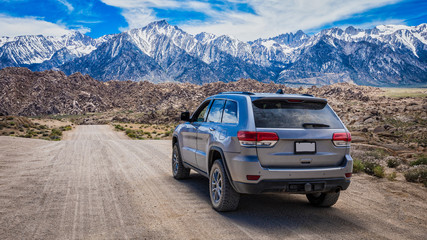 SUV on Mountain Dirt Road Wall mural