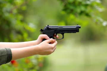 Young girl practice shooting guns on outdoor