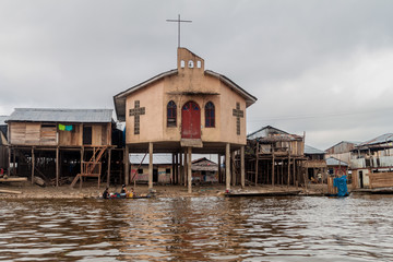 IQUITOS, PERU - JULY 18, 2015: View of a church in partially floating shantytown in Belen neigbohood of Iquitos, Peru.