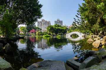 Bridge and a pond on the grounds of the Chiang Kai Shek Memorial Hall in Taipei, Taiwan