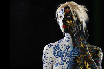 Body art of a girl in the style of Khokhloma and Gzhel