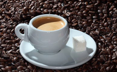 cup of coffee on the background of coffee beans