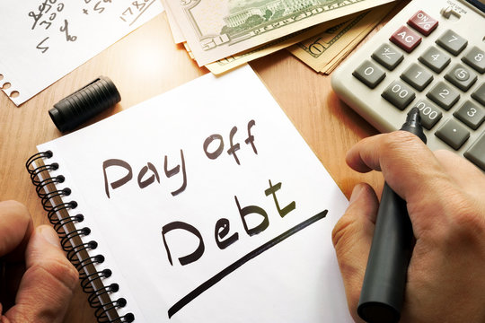 Note with words pay off debt concept.