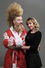 funny Santa Claus with a beautiful girl