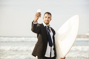 Businessman makifn a selfie