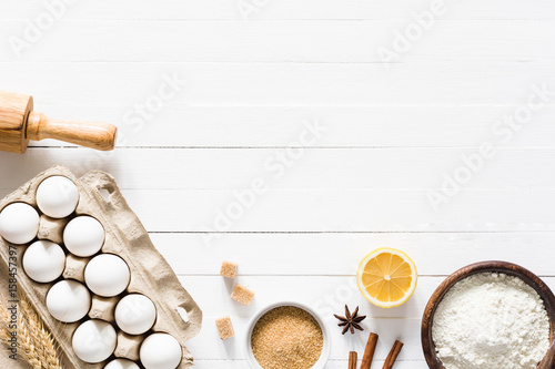 Baking Ingredients On White Table. Box Of White Eggs, Brown Sugar, Spices,