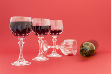 Getting drunk from red wine in elegant crystal glasses