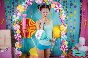 funny Korean girl with big colorful Lollipop
