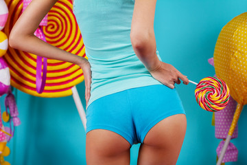woman in bright short shorts with Lollipop