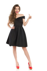 Elegant Excited Woman In Black Dress Gives Thumb Up