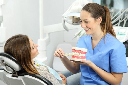 Dentist explaining how to brush teeth