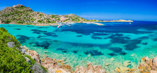 Emerald green sea water and rocks on coast of Maddalena island, Sardinia, Italy Wall mural