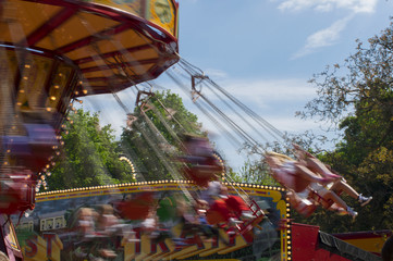 Swinging ride at a carnival with motion blur