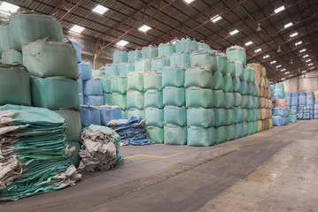 Big bags stack that contain the rice in warehouse