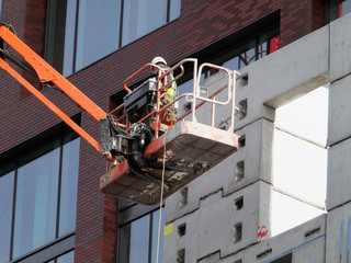 worker on an elevated construction platform on modern building development