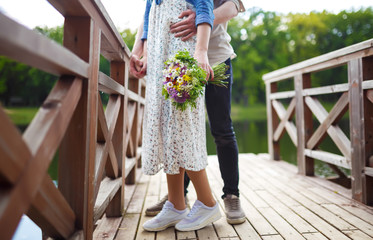 beautiful young girl with a bouquet of flowers. couple together