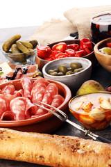 spanish tapas and sangria on wooden table - mediterran antipasti