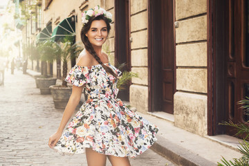 Happy woman in beautiful dress on the street