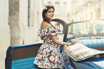 Beautiful woman and retro car