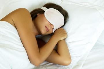 Sleeping woman with eye mask