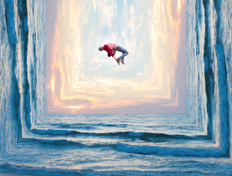 Photo manipulation of a tall man letting go of all his worries as he floats weightlessly above the clouds and waves..