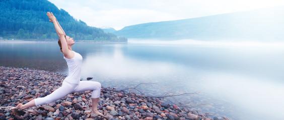 Yoga woman near fjord