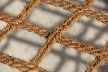 Coir - Natural cocos fibre ropes connected to a grid