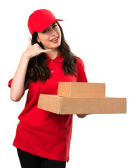 Delivery woman making phone gesture