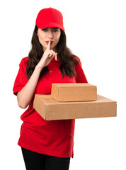 Delivery woman making silence gesture