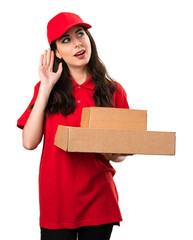Young delivery woman listening something