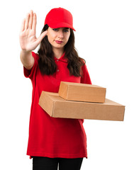Young delivery woman making stop sign