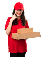 Young delivery woman showing something