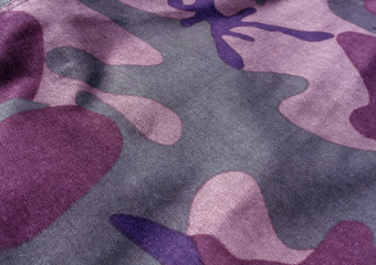 Camouflage textile uniform close-up with blur effect.